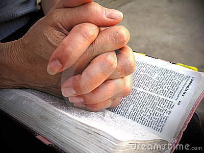 Praying on bible