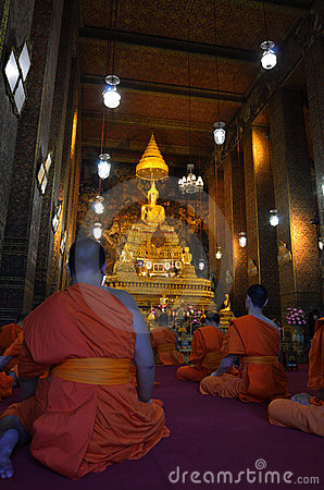 Praying buddhist monks Editorial Photography