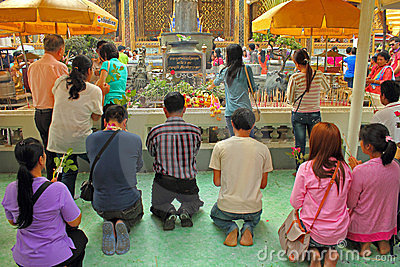 Praying buddhists Editorial Stock Photo