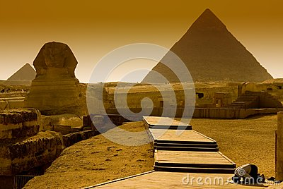 The praying Egyptian at a pyramid in Giza, Egypt