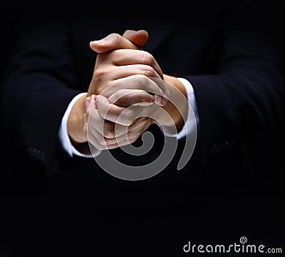Praying hands on black