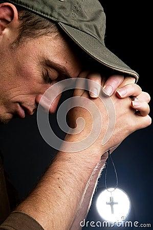 Free Praying Man Holding A Cross Royalty Free Stock Image - 6145506