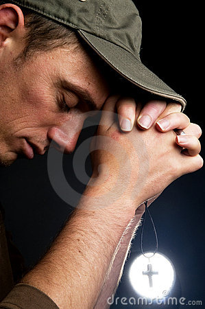 Praying Man Holding A Cross