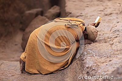 Praying man in Lalibela, Ethiopia Editorial Stock Image