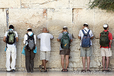 Praying men at Western wall in Jerusalem, Israel Editorial Photo