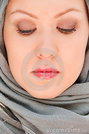 Praying moslem woman close-up portrait