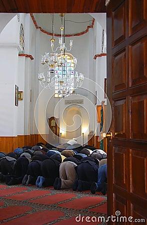 Praying Muslim men