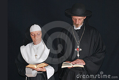 Praying nun and priest