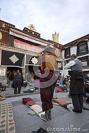 Praying tibetan Editorial Stock Photo