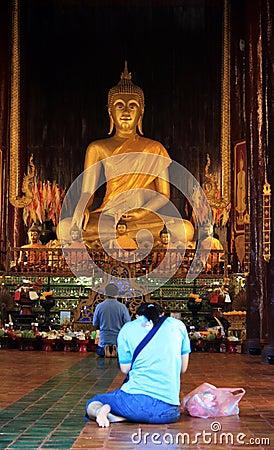 Praying to Buddha