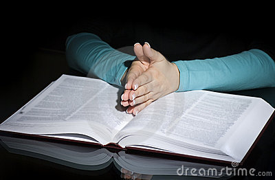 Praying woman and bible