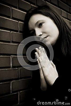 Praying woman in dark