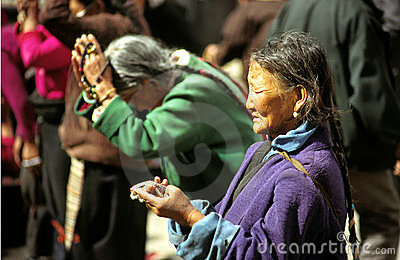 Praying woman tibet Editorial Stock Photo