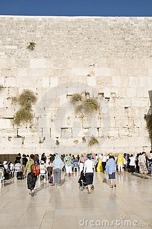Praying women and tourists near Jerusalem wall Editorial Stock Image