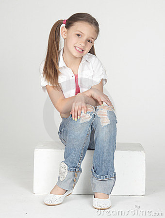 Girl Wearing Blue Jeans and White Top in Ponytails Sitting on White ...