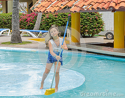 Pretty girl cleaning the swimming pool island with stock - Long island swim school garden city ...