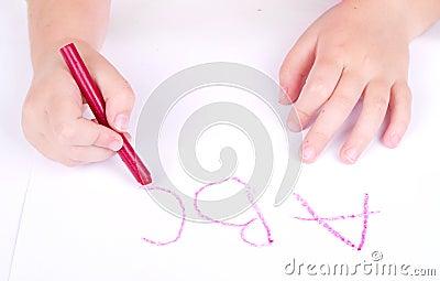 Prechool age child writing alphabet