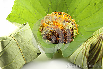 Precision herbal rice wrapped in lotus leaf.