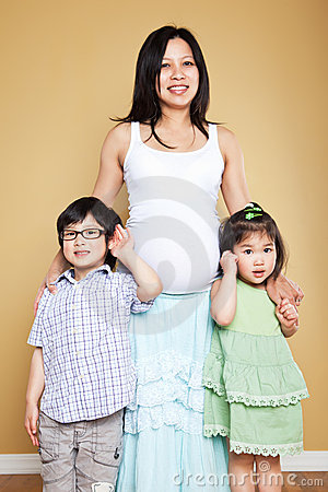 Pregnant Asian mother and her kids