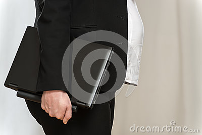 Pregnant business woman with laptop