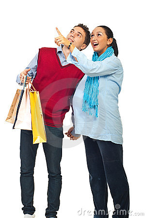 Free Pregnant Couple At Shopping Pointing Up Royalty Free Stock Photography - 17097097