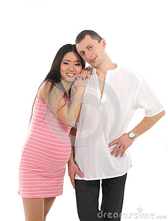 Pregnant couple Caucasoid father, mother asian