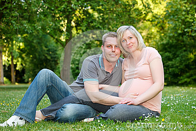 Pregnant couple in the park