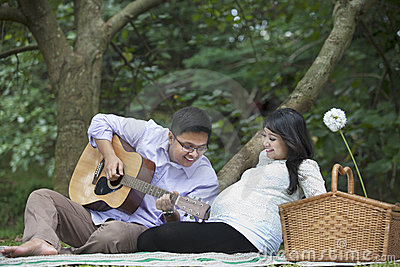 Pregnant couple picnic in the nature