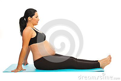Pregnant doing fitness exercise
