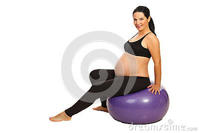 Pregnant doing fitness exercises