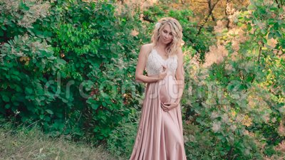 Pregnant Elf With Blond Curly Hair Lady In A Wonderful Perfect Pink