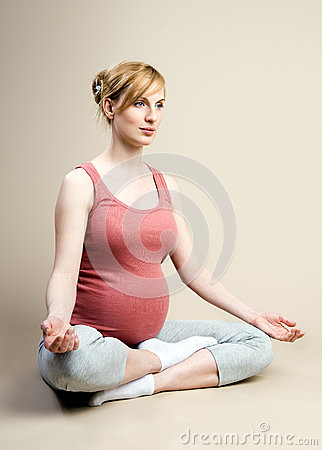 Pregnant female is engaged in yoga