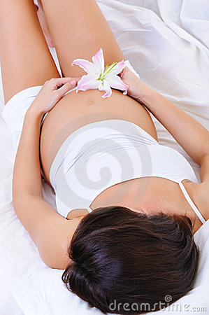 Free Pregnant Female With The Flower On Her Belly Stock Images - 11538164