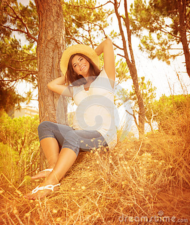 Pregnant girl in autumnal garden royalty free stock image for Gardening while pregnant