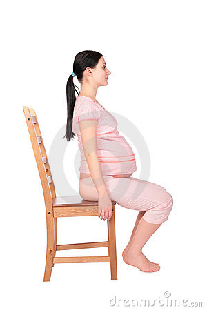 Free Pregnant Girl Sits On Chair Sideview Stock Photography - 4941652