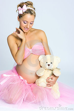 Free Pregnant Girl With Teddy Bear Royalty Free Stock Image - 11451536