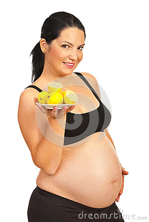 Pregnant holding plate with lemons