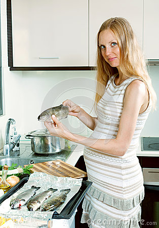 Surprised woman cooking trout stock images image 20226874 for Fish dream meaning pregnancy