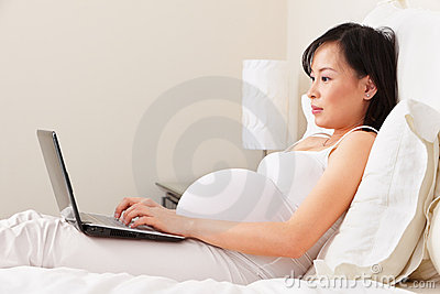 Pregnant lady using laptop