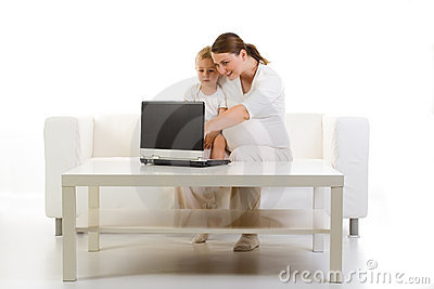 Pregnant mother and child using PC
