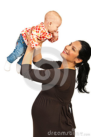 Pregnant mother playing with baby