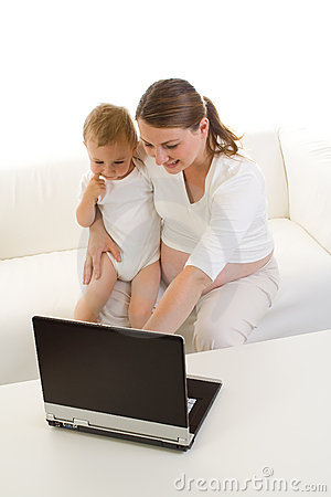Pregnant mother using laptop