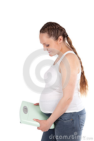 Pregnant nice woman, scales, isolation
