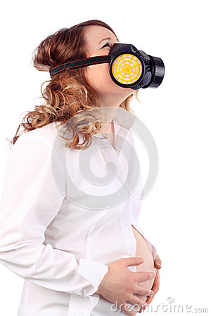 Pregnant suffering woman and respirator holds belly