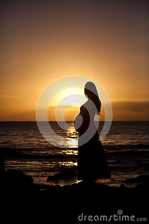 Free Pregnant Woman At Sunset Royalty Free Stock Photos - 27857028