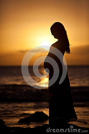 Free Pregnant Woman At Sunset Royalty Free Stock Photos - 35335828