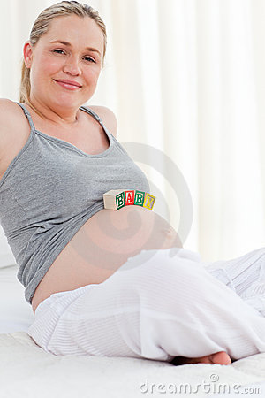 Pregnant woman with baby cubes on her belly