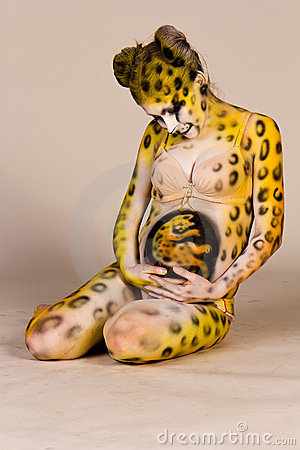 Pregnant woman with body-art as leopard