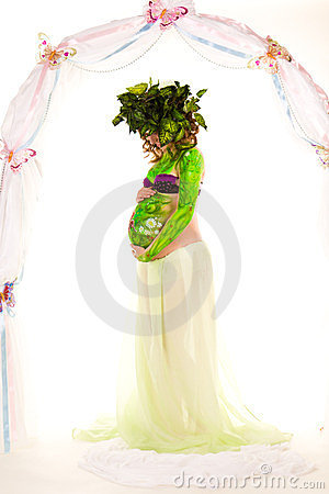 Pregnant woman with body-art with green leaves