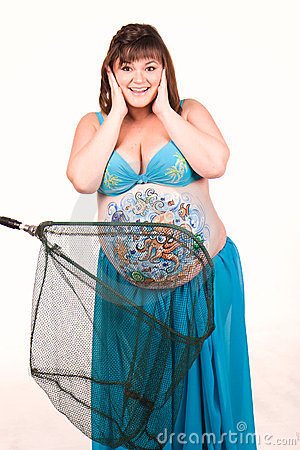 Pregnant woman with body-art of sea life
